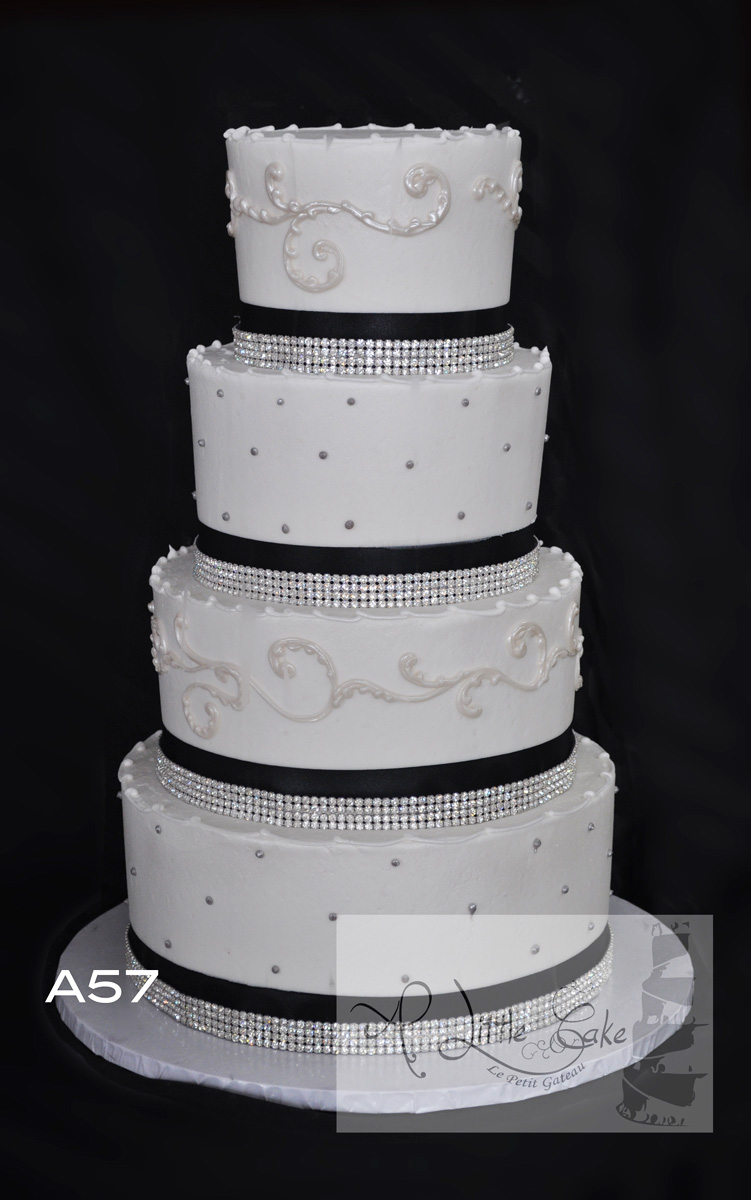 A57 Buttercream Wedding Cake With Black Bands And Silver