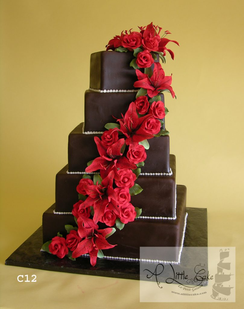 C12 Brown Fondant Wedding Cake With White Beads And Red Flower