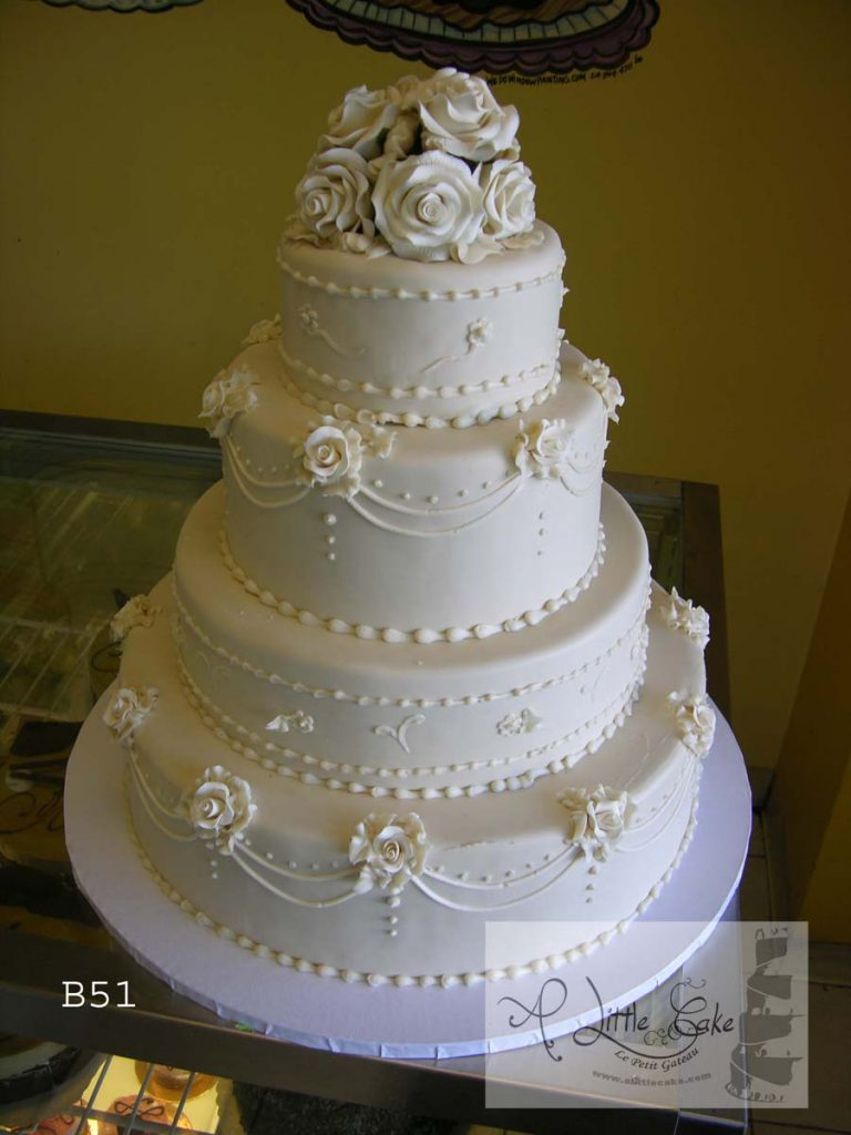 C511 Layered Fondant Wedding Cake With Elegant Rose Design